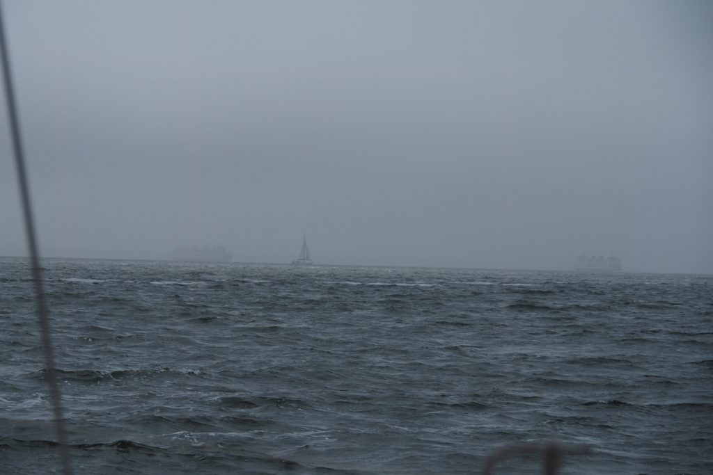 Two ferries between Den Helder and Texel crossing in the fog - and a sailing boat