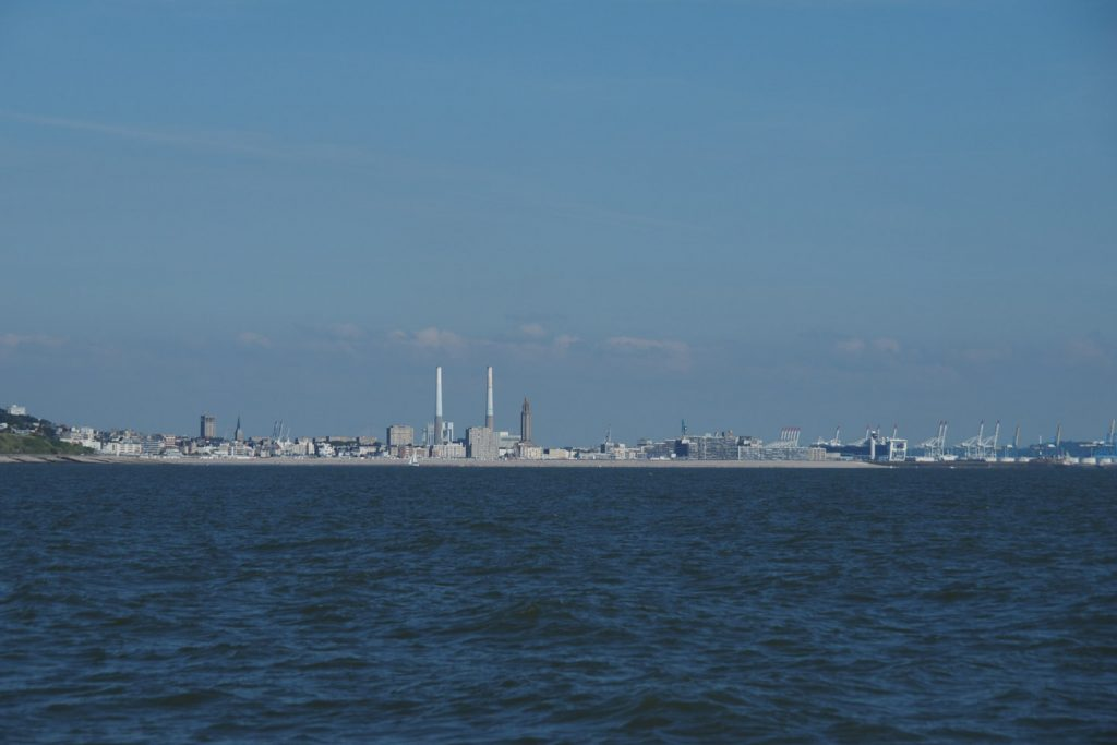 Approach of Le Havre with the tower of St.Joseph's church visible (and chimneys)